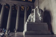 Washington D.C./ USA - 07.12.2013: Tourists visiting Lincoln Memorial, looking at the statue of Abraham Lincoln. royalty free stock photography