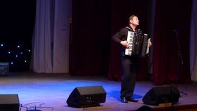Famous accordionist Vladimir Zuban. DNIPRO, UKRAINE - SEPTEMBER 23, 2017: Famous accordionist Vladimir Zuban performs Ukrainian folk songs at the Philharmonic stock video