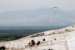 Famous and amazing thermal springs Pamukkale or Cotton Castle on Denizli Province in Turkey. And Paragliding stock photography