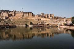 Famous Amer Fort. View of the Maota lake and beautifully decorated, majestic Amber Fort in Jaipur, Rajasthan. The lush green Aravalli hill range is also seen on Royalty Free Stock Photography