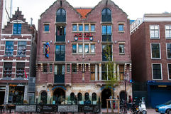 Famous Amsterdam Bulldog coffeeshop and hotel in red-light district during the evening, the Netherlands. Stock Photos
