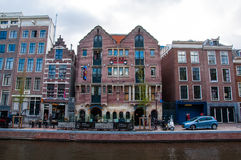 Famous Amsterdam Bulldog coffeeshop and hotel in red-light district during the evening, the Netherlands. Stock Photography