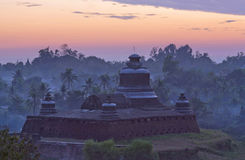 Famous ancient Htukkanthein stupa at sunset in Mrauk U, Rakhine Royalty Free Stock Images