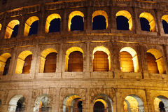 The famous ancient Roman Colosseum structure illuminated during dusk Stock Photography