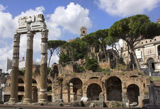 Famous ancient Roman Forum, Rome, Italy. Antique ruins of famous ancient Roman Forum on the background of bright blue sky with unusual clouds, Rome, Italy Royalty Free Stock Image