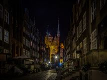 Famous ancient street Mariacka in Gdnask in the nigh full of small shops royalty free stock images