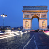 Famous Arc de Triomphe by night. View of  famous Arc de Triomphe by night, Paris Royalty Free Stock Image