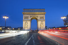 The famous Arc de Triomphe by night Stock Photos