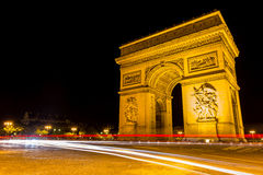 Famous Arc de Triomphe in Paris, France. At night Royalty Free Stock Images