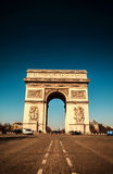Famous Arc de Triumph. Paris, Famous Arc de Triumph with flag of France Royalty Free Stock Images