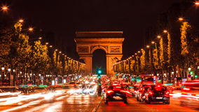 Famous Arc de Triumph. Paris, Famous Arc de Triumph with flag of France Royalty Free Stock Photos