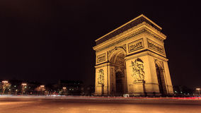 Famous Arc de Triumph. Paris, Famous Arc de Triumph with flag of France Royalty Free Stock Photo