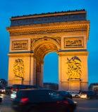 Famous Arch de Triumph, Paris. Traffic on Paris road in front of Triumph Arch. Paris Stock Image