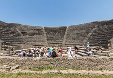 The famous archaeological site of Pompeii UNESCO heritage. Crowd of tourists under the scorching sun. Pompeii, Italy - June 15, 2017: The famous archaeological stock photography