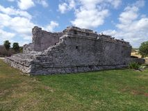 Famous archaeological site with stony ruins of mayan temple at TULUM city at Mexico on grassy field. Famous archaeological site with stony ruins of mayan temple stock images