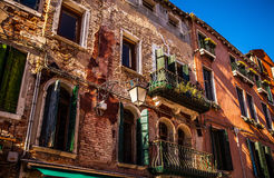 Famous architectural monuments and colorful facades of old medieval buildings close-up n Venice, Italy. VENICE, ITALY - AUGUST 17, 2016: Famous architectural Royalty Free Stock Photo