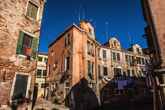 Famous architectural monuments and colorful facades of old medieval buildings close-up n Venice, Italy. VENICE, ITALY - AUGUST 17, 2016: Famous architectural Stock Images