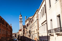 Famous architectural monuments and colorful facades of old medieval buildings close-up n Venice, Italy. VENICE, ITALY - AUGUST 17, 2016: Famous architectural Stock Photos