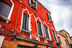 Famous architectural monuments and colorful facades of old medieval buildings close-up n Venice, Italy. Stock Photography