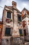 Famous architectural monuments and colorful facades of old medieval buildings close-up n Venice, Italy. Royalty Free Stock Photos
