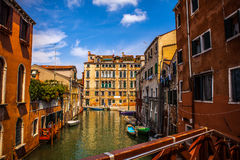 Famous architectural monuments and colorful facades of old medieval buildings close-up n Venice, Italy. Stock Images