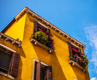 Famous architectural monuments and colorful facades of old medieval buildings close-up n Venice, Italy. Stock Photos