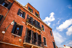 Famous architectural monuments and colorful facades of old medieval buildings close-up n Venice, Italy. Royalty Free Stock Images