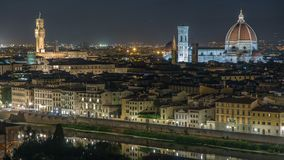 Famous Arnolfo tower of Palazzo Vecchio timelapse and Basilica di Santa Maria del Fiore at night in Florence, Tuscany. Famous Arnolfo tower of Palazzo Vecchio stock video