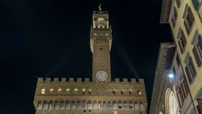 Famous Arnolfo tower of Palazzo Vecchio timelapse on the Piazza della Signoria at twilight in Florence, Tuscany, Italy stock video