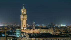 Famous Arnolfo tower of Palazzo Vecchio timelapse on the Piazza della Signoria at twilight in Florence, Tuscany, Italy. Famous Arnolfo tower of Palazzo Vecchio stock video footage