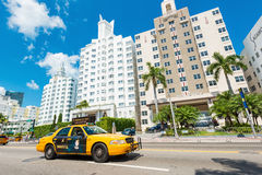 Famous art deco hotels and traffic  at Collins Avenue in Miami B Stock Photo