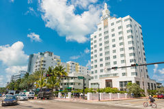 Famous art deco hotels and traffic  at Collins Avenue in Miami B Royalty Free Stock Photo