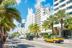 Famous art deco hotels and traffic  at Collins Avenue in Miami B Stock Images