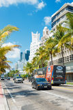 Famous art deco hotels and traffic  at Collins Avenue in Miami B Royalty Free Stock Image