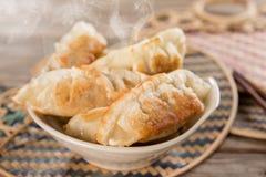 Famous Asian gourmet pan fried dumplings Stock Photos