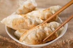 Famous Asian meal pan fried dumplings Stock Photos