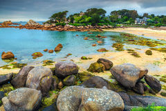 Famous Atlantic ocean coast with granite stones,Perros-Guirec,France. Spectacular rocky beach with pink granite stones and wonderful green gardens on the coast Royalty Free Stock Photos