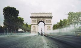 Famous avenue Champs-Elysees and the Triumphal Arch, symbol of the glory and historical heritage. Iconic touristic Royalty Free Stock Image