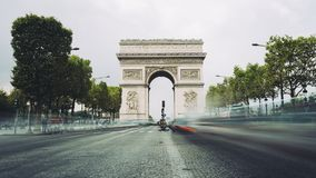 Famous avenue Champs-Elysees and the Triumphal Arch, symbol of the glory and historical heritage. Iconic touristic Stock Photos