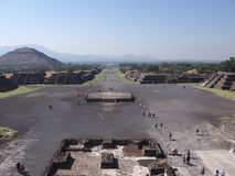 Famous Avenue of the Dead and pyramid of the Sun on left at Teotihuacan ruins near Mexico city landscape. Famous Avenue of the Dead and pyramid of the Sun on royalty free stock image