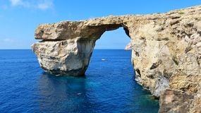 The famous Azure Window in Malta. An arch of rock that forms a doorway to the open sea Royalty Free Stock Photography