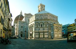 Famous Baptistery of San Giovanni and Santa Maria del Fiore cathedral church in early morning, Florence, Tuscany, Italy. stock photography