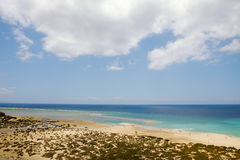Famous beach Playa de Sotavento, Fuerteventura, Spain. Aerial view on famous beach de Playa Sotavento with blue ocean water, lagoons and sand dunes on the royalty free stock images