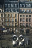 Famous Beaubourg pipes in front of the typical Parisian building Royalty Free Stock Photos