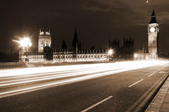 Famous and Beautiful night view to Big Ben and Houses of Parliam. Ent with Westminster bridge through night traffic, London, UK Royalty Free Stock Photos
