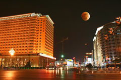 The famous Beijing Grand Hotel and Moon Eclipse Royalty Free Stock Images