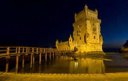 Famous Belem tower after sunset during the blue hour in Lisbon, Portugal. Stock Photos