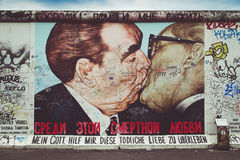 Famous Berlin Wall street art graffiti 'The Kiss' at East Side Gallery, Germany Stock Photography