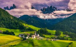 Famous best alpine place of the world, Santa Maddalena St Magda. Lena village with magical Dolomites mountains in background, Val di Funes valley, Trentino Alto Royalty Free Stock Photography