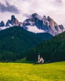 Famous best alpine place of the world, Santa Maddalena St Magda. Lena village with magical Dolomites mountains in background, Val di Funes valley, Trentino Alto Royalty Free Stock Photo
